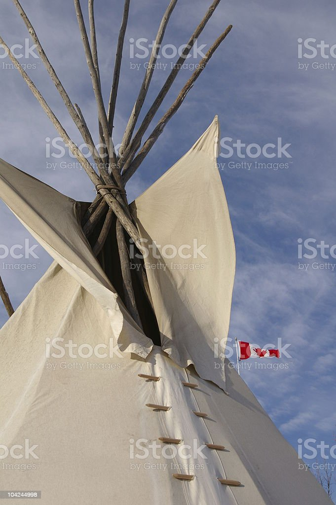 Teepee with flag royalty-free stock photo