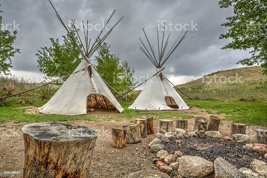 Teepees by a Fire Pit stock photo