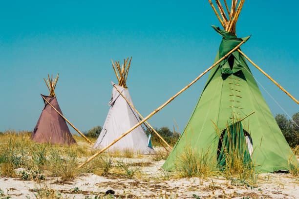 teepees on the sea shore - native american reservation stock photos and pictures