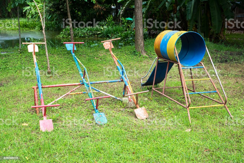 Teeter Totter and slider at playground for Children play stock photo