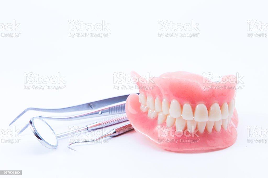 teeth and dental mirror, symbol photo of dentures, stock photo