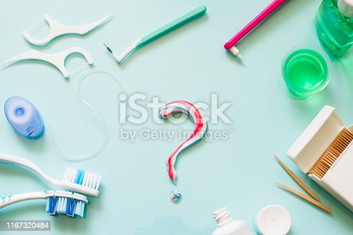 Teeth care frame concept with manual toothbrushes and oral hygiene products