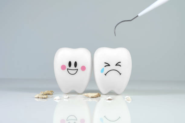 Teeth smile and crying emotion with dental plaque tool stock photo