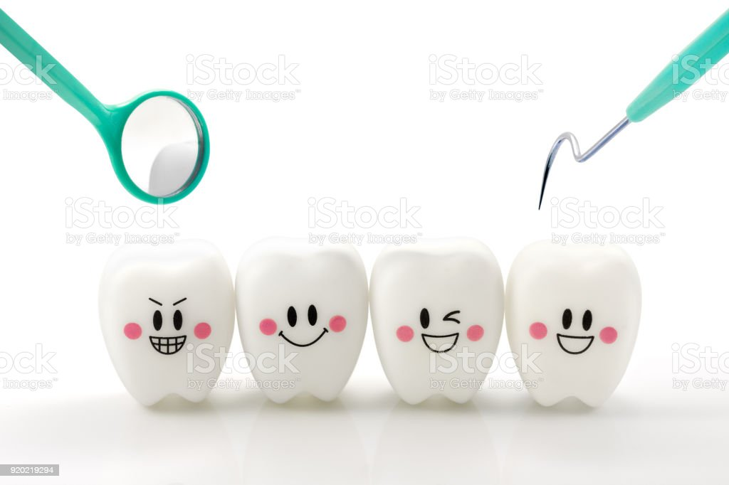Teeth smile emotion with dental mirror and dental plaque cleaning tool isolated on white background, With clipping path stock photo