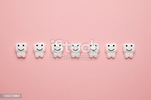 istock Teeth whitening, enamel. Cleanliness and hygiene of oral cavity for children. Cartoon anatomy on pink background 1253225831