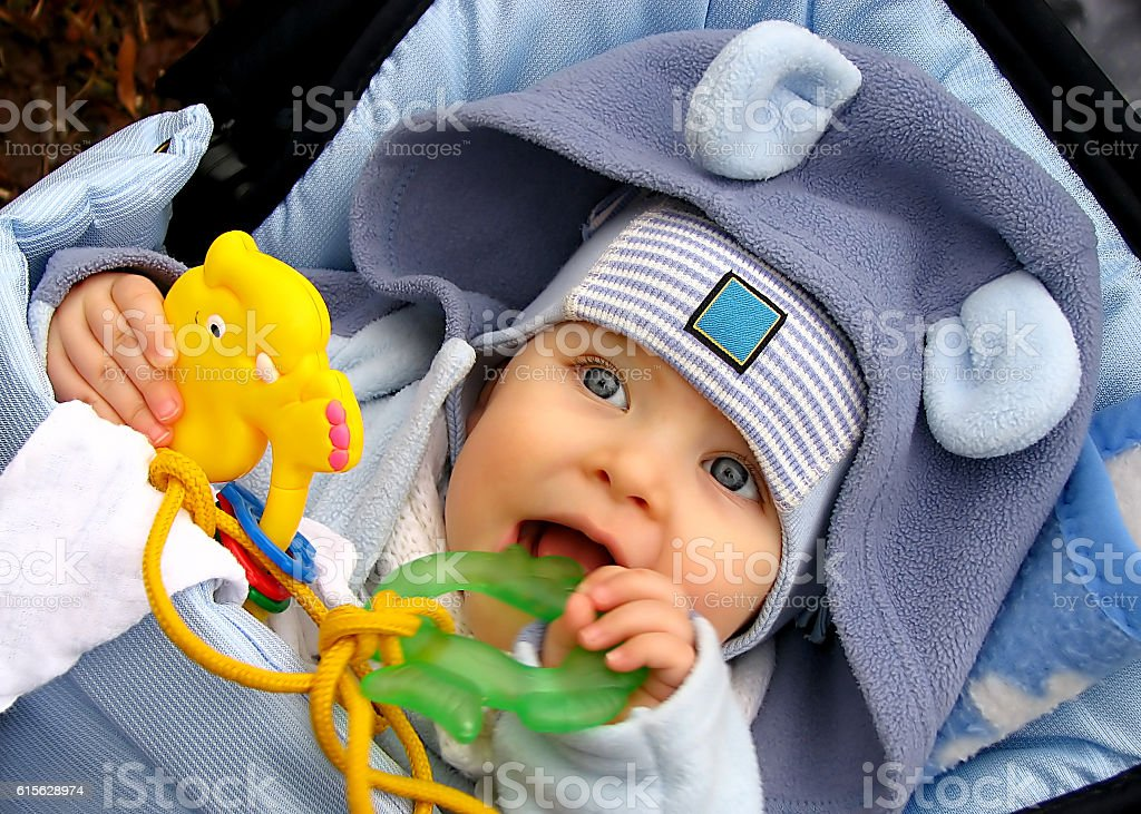 Teething baby stock photo