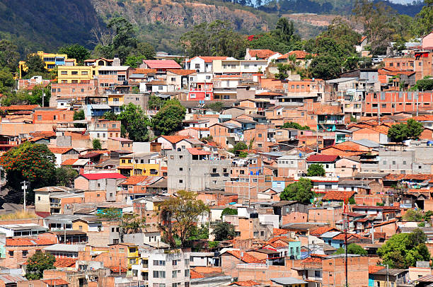Tegucigalpa, Honduras: informal construction Tegucigalpa, Honduras: slums on the hills surrounding the capital - Francisco Morazán department, Distrito Central - photo by M.Torres honduras stock pictures, royalty-free photos & images
