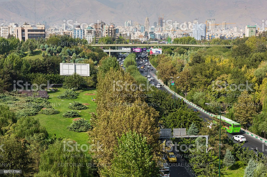Tehran skyline and greenery in front of Alborz Mountains stock photo
