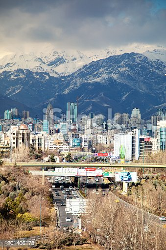 Tehran with mountain in background