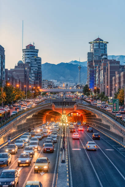 06/05/2019 Tehran,Iran,Famous night view of Tehran,Flow of traffic round Tohid Tunnel with Milad Tower and Alborz Mountains in Background, Tohid Tunnel one of longest urban tunnel in Middle East stock photo