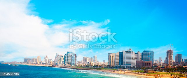 View of Tel Aviv beach at and cityscape on a sunny day.