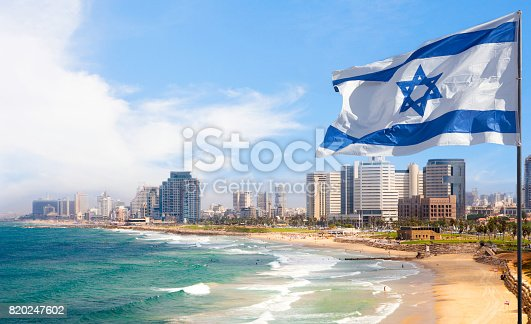 View of Tel Aviv beach in summer time with Israel Flag