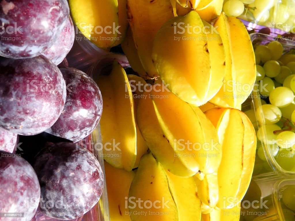 Tel Aviv Plums, Star Fruit and Grapes 2011 stock photo