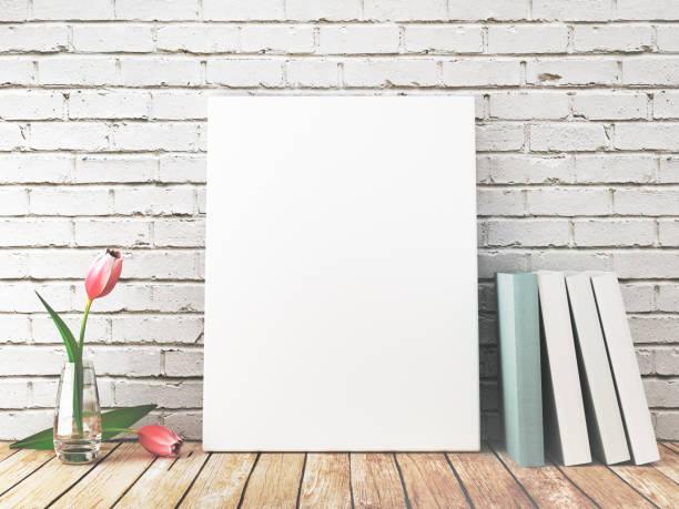 Tela bianca o frame appoggiata a muro con fiori e libri, 3d Tela bianca per fotografie o quadri appoggiata al muro su mensola libro stock pictures, royalty-free photos & images