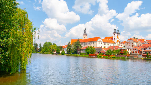 Telc Panorama. Water reflection of houses and Telc Castle, Czech Republic. UNESCO World Heritage Site Telc Panorama. Water reflection of houses and Telc Castle, Czech Republic. UNESCO World Heritage Site. moravia stock pictures, royalty-free photos & images
