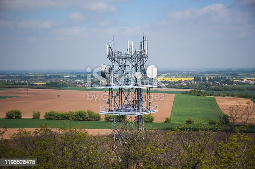 istock Telecommunication and Communication Tower Antenna, Technology 3G,4G of Industrial Transmission Network. In the forrest. 1195528475