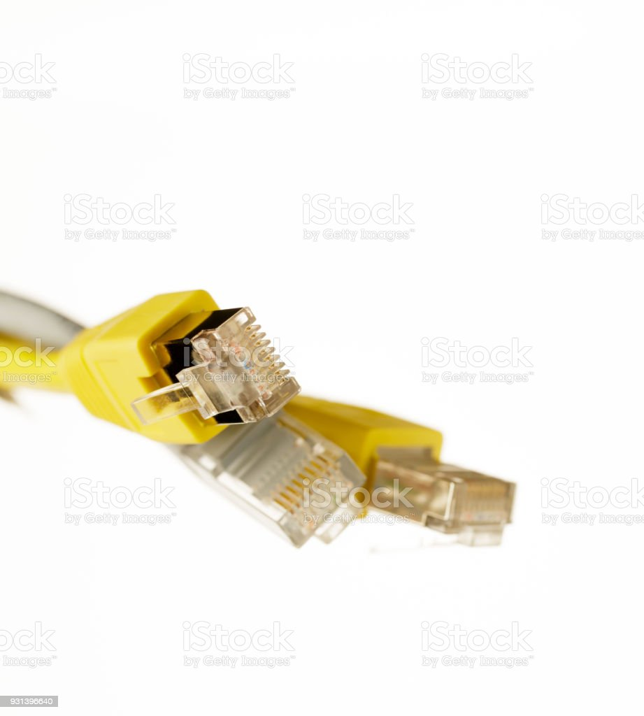 Telecommunication cable with yellow RJ45 plug stock photo