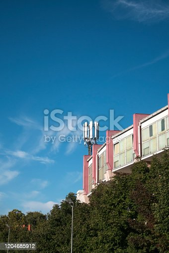 1169777785istockphoto Telecommunication cellular base station on a building 1204685912