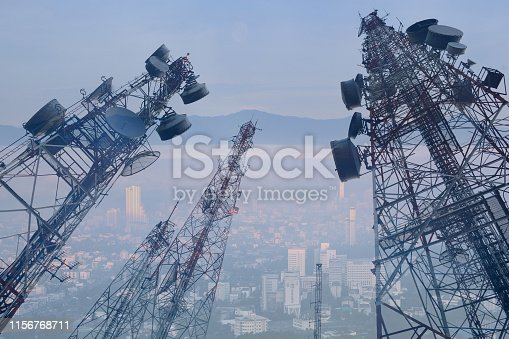 double exposure telecommunication mast TV antennas wireless technology with blue sky in the morning with light background
