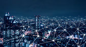 istock Telecommunication network above city, wireless mobile internet technology for smart grid or 5G LTE data connection, concept about IoT, global business, fintech, blockchain 1144557228