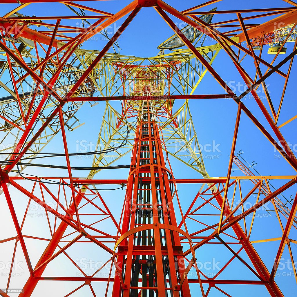 Telecommunication tower against the blue sky royalty-free stock photo