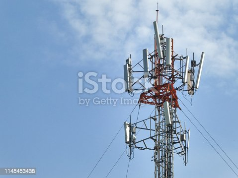 istock Telecommunication tower against the blue sky with clouds. 1145453438