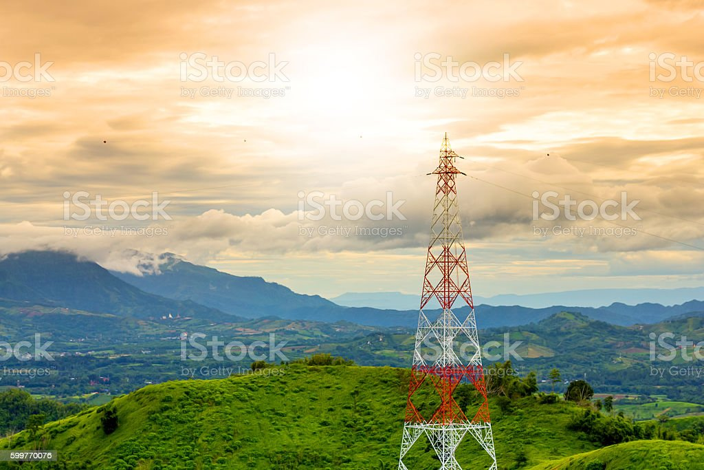 telecommunication tower during sunset mountain background in rainy season stock photo
