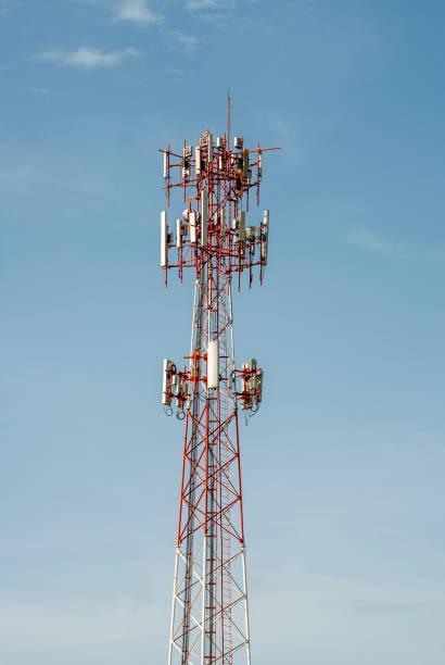 telecommunication tower illuminated with natural light outdoors with blue sky. - emissione radio televisiva foto e immagini stock