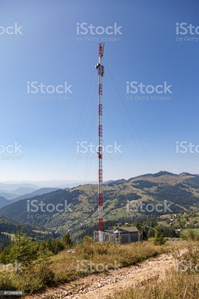 Telecommunication tower in the mountains stock photo