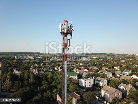1169777785istockphoto Telecommunication tower of 4G and 5G cellular. Base Station or Base Transceiver Station. Wireless Communication Antenna Transmitter. Telecommunication tower with antennas against blue sky. 1160576226