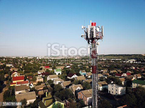 1169777785istockphoto Telecommunication tower of 4G and 5G cellular. Base Station or Base Transceiver Station. Wireless Communication Antenna Transmitter. Telecommunication tower with antennas against blue sky. 1160781448