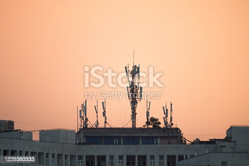 Telecommunication tower of 4G and 5G cellular on top of building