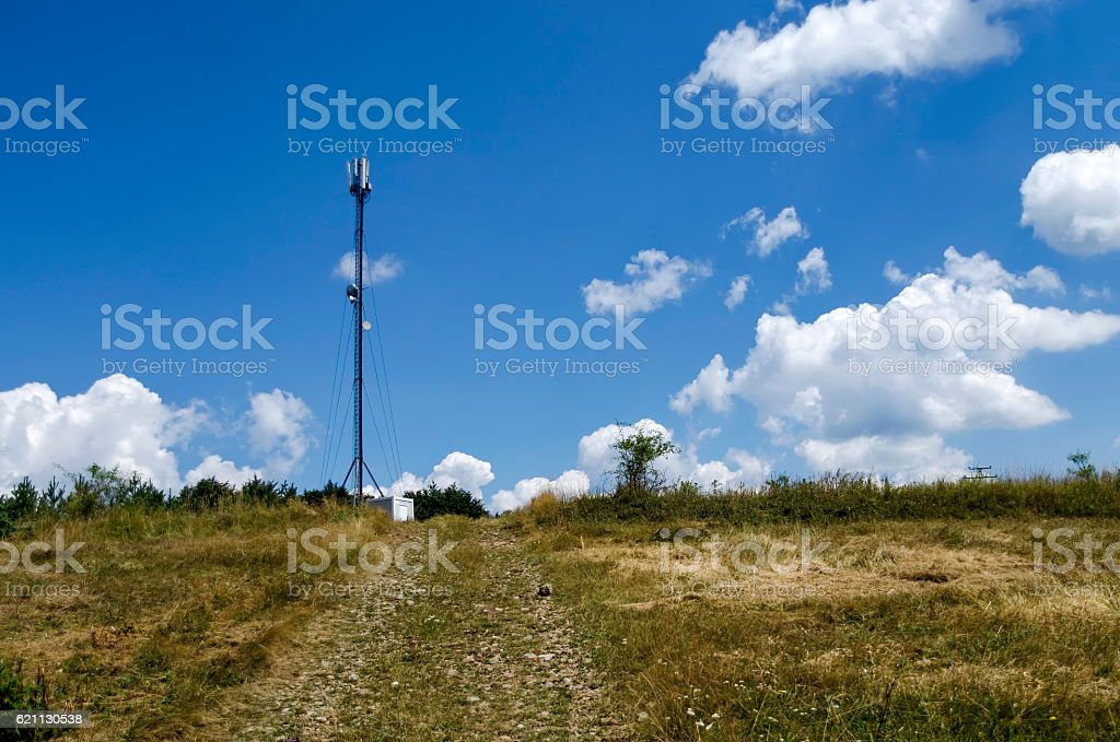 Telecommunication tower with antenna of advance summer stock photo