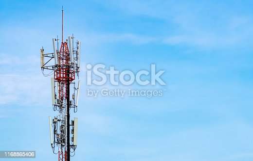 1169777785istockphoto Telecommunication tower with blue sky and white clouds background. Antenna on blue sky. Radio and satellite pole. Communication technology. Telecommunication industry. Mobile or telecom 4g network. 1168865406