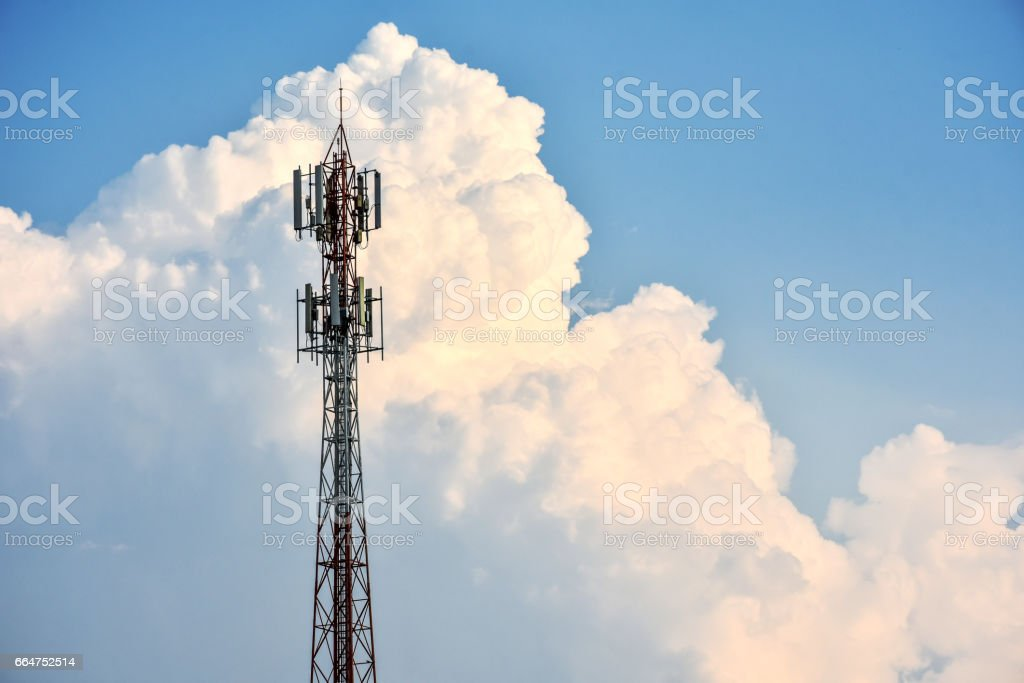 Telecommunication tower withclouds and blue sky in background. stock photo