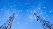 istock Telecommunication towers with mesh dots, glittering particles for wireless telecommunication technology 1248402112