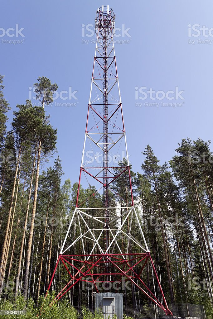 Telecommunications electrical red white tower stock photo