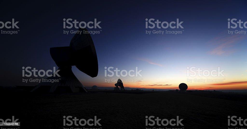 Telecommunications Satellites at night stock photo