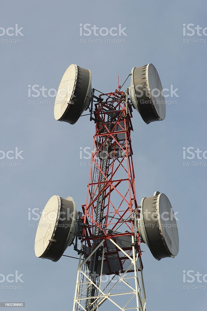 telecommunications tower with many satellite dish stock photo
