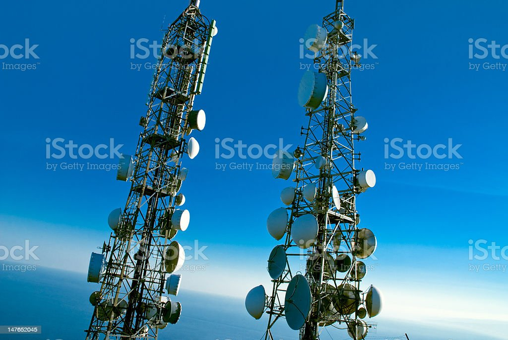 telecommunications towers stock photo