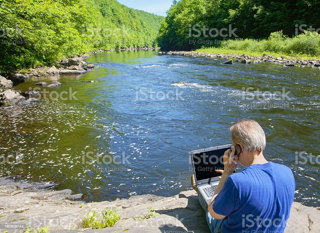 Telecommuting By The River stock photo