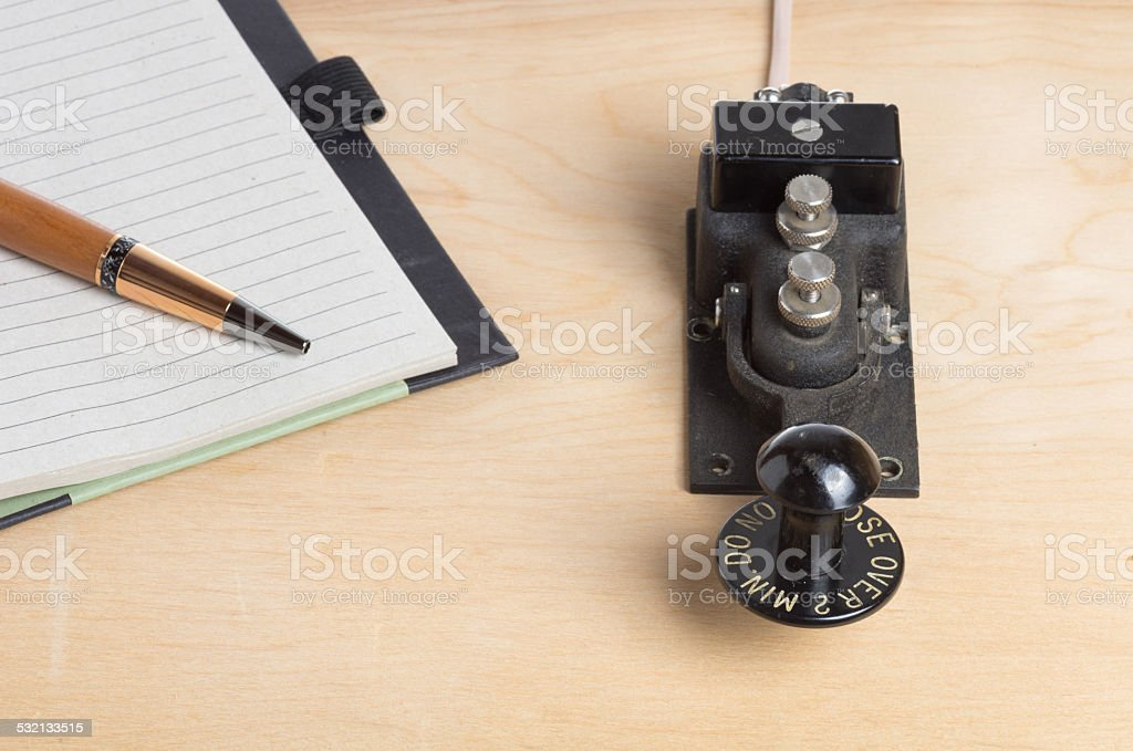 Telegraph key and notebook and pen stock photo
