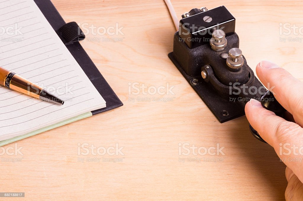 Telegraph key and notebook stock photo