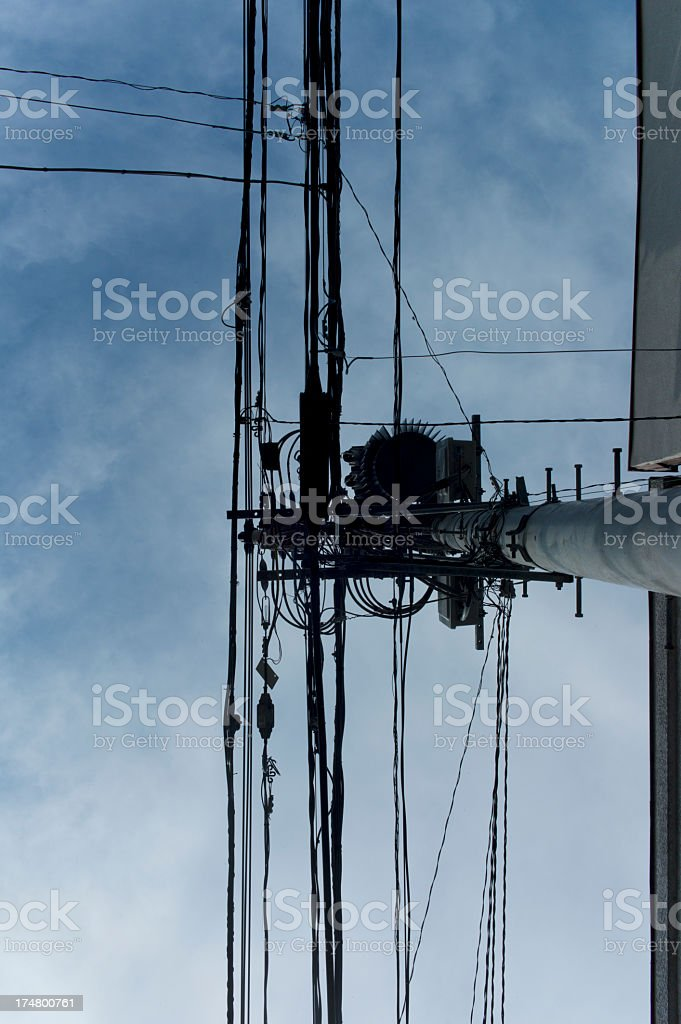 Telegraph pole is looked up at. royalty-free stock photo