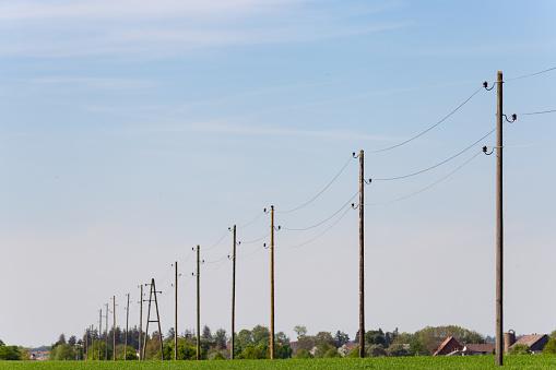 telegraph pole on blue sky horizon
