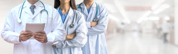 Telehealth, telemedicine doctor teamwork, surgeon, ER surgery team working in hospital medical clinic office diagnostic examining on patient care operation, professional teleclinic service stock photo
