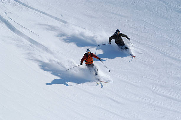 Telemarkers heading down the slopes in Neve Fresca stock photo