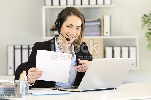 istock Telemarketer attending a call at office 1061386714