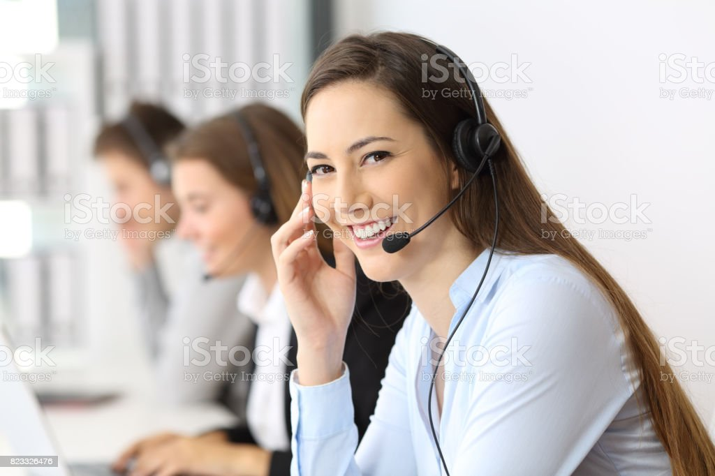 Telemarketer looking at you at office stock photo