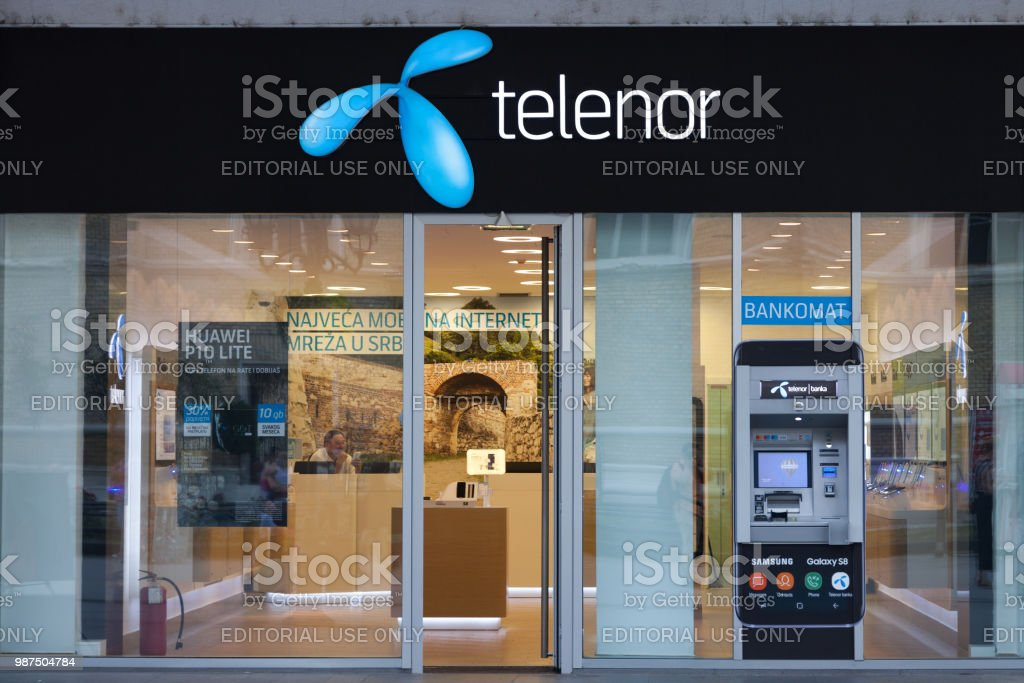 Telenor logo in front of their main shop in Novi Sad, with an ATM from the bank Telenor Banka. Telenor ASA is a Norwegian telecommunications company